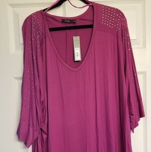 Shirt with studded sleeves